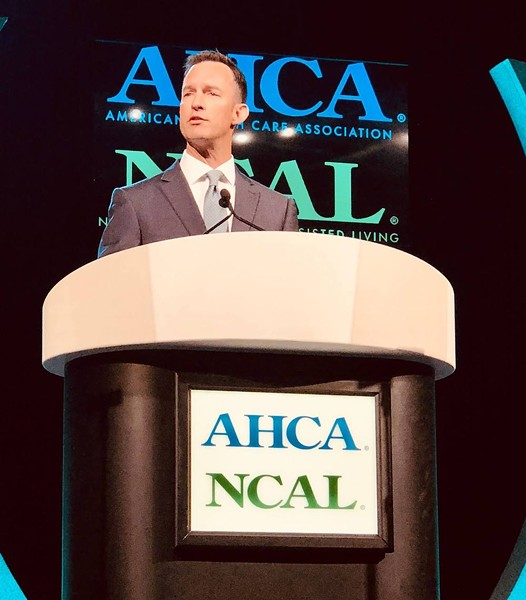 Scott Title speaking at a general meeting in 2018 - AMERICAN HEALTH CARE ASSOCIATION/ NATIONAL CENTER FOR ASSISTED LIVING FACEBOOK