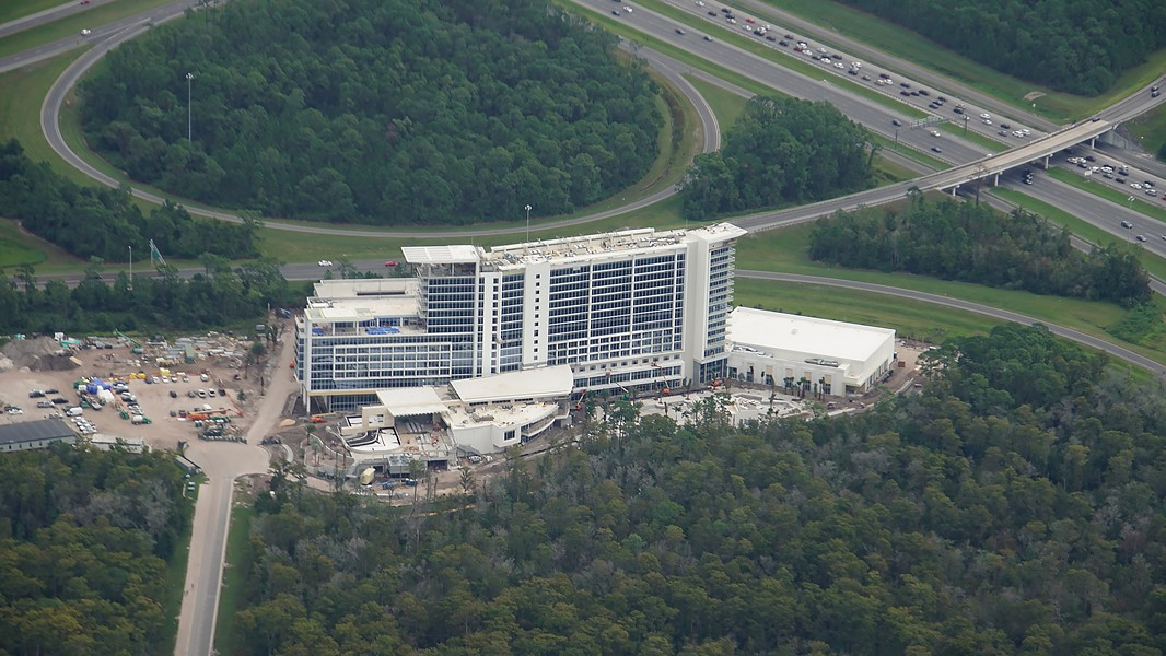 An aerial image from late 2019 showing the then still under construction JW Marriott Bonnet Creek Creek Resort & Spa with traffic on nearby I-4 seen in the upper corner of the image. - IMAGE VIA BIORECONSTRUCT | TWITTER