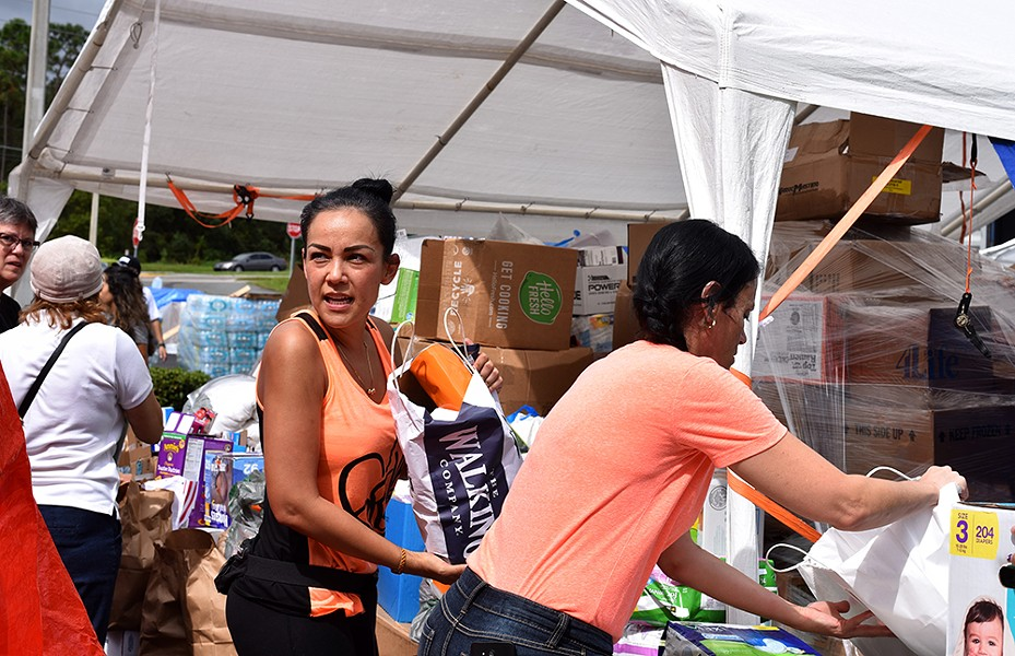 Orlando's Puerto Rican community gathers supplies for the island on Sept. 30. - PHOTO BY MONIVETTE CORDEIRO