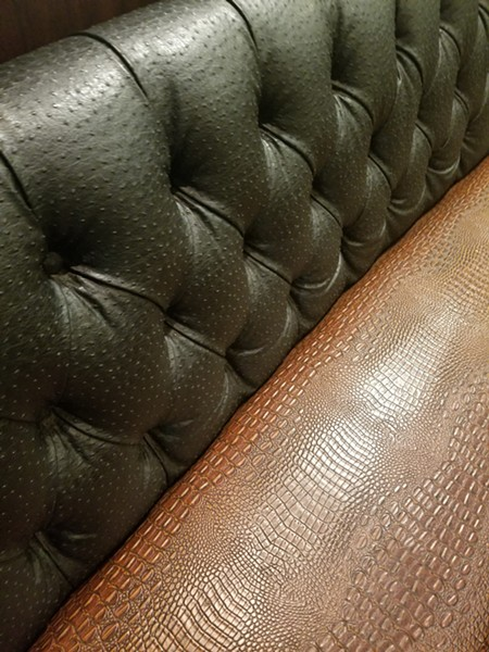 A faux gator and ostrich leather booth at the SODO McDonald's