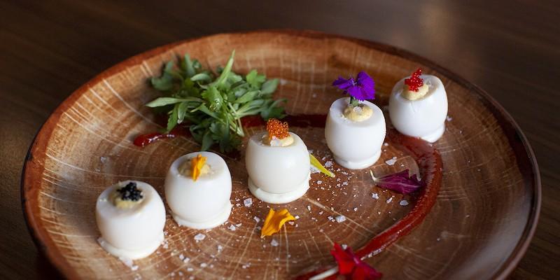 Sriracha deviled quail eggs with tobiko and truffle oil