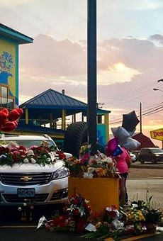 A makeshift memorial on cars left in the parking lot of the Branson Ride the Ducks.