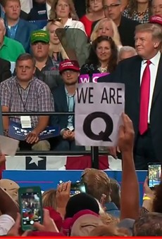 Conspiracy theory group QAnon made an unusually large debut at Trump's Tampa rally
