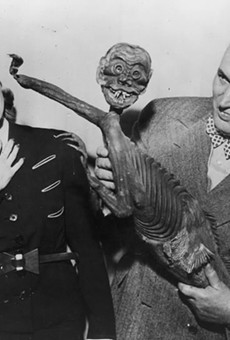 """Robert Ripley with the """"Fiji Mermaid"""", which turned out to be a hoax consisting of a monkey torso attached to a fish."""