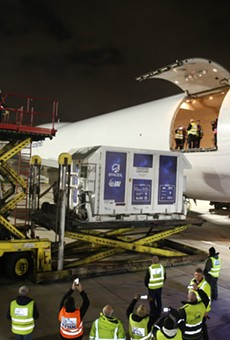 Locked in a custom shipping container, Beresheet is loaded onto a cargo plane at the Ben Gurion Airport in Israel for its flight to Orlando.