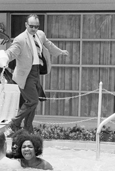 """The owner of the Monson Motor Lodge in St. Augustine attempting to enforce his """"whites only"""" pool rules in 1964."""