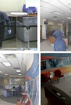 Three men robbed a bank on John Young Parkway this morning