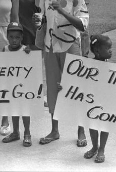 Two children protest poverty in Tallahassee in 1987.