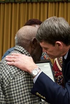 Groveland Mayor Tim Loucks hugs a relative of the Groveland Four.