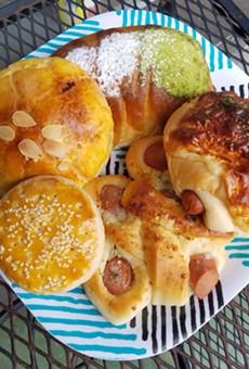 Clockwise from top: Matcha bun, cheese and hot dog bun, garlic and hot dog bun, Sweetheart cookie, pineapple taro bun