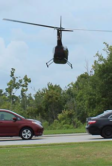 Local pilot arrested for flying tour helicopter within a few feet of cars