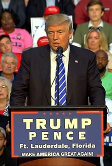 Disgraced ex-congressman Mark Foley sits behind Trump at Florida rally
