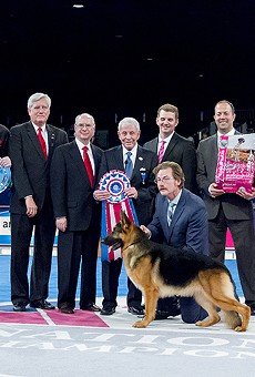 Yep, that's Alan Grayson holding a big silver doggie dish on the left.