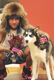 Riff Raff aka Jody Highroller, aka Iceberg Simpson, aka Kokayne Dawkins, aka The Peach Panther with his dog Jody Husky