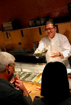 "Iron Chef Morimoto serves a guest at the last ""Momakase"" dinner."