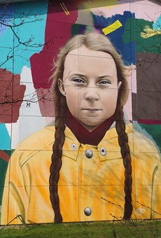 """A 2019 mural in Hillerød, Denmark by Danish artist Miki Pau Otkjær called """"Save the Planet Now"""" depicts Swedish climate activist Greta Thunberg."""