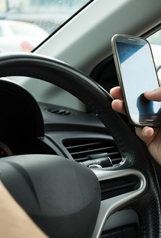 Starting today, drivers can be pulled over for holding a cell phone near schools and construction areas