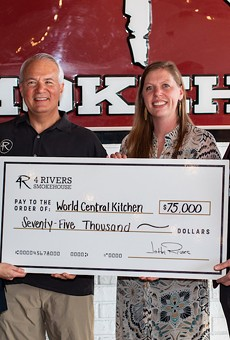 Sara Elliot and John Rivers of 4 Rivers Smokehouse present a check to Erin Gore and Nate Mook from World Central Kitchen for Hurricane Dorian Relief Efforts