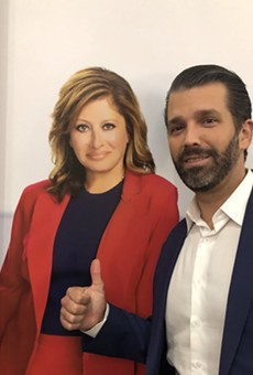 Donald Trump Jr. with cardboard. No, that's not his book.