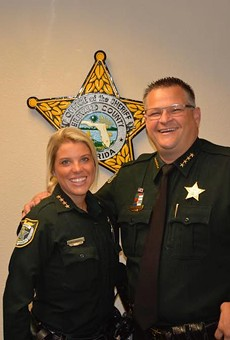 "If you don't fit in with the Evangelical motto ""In God We Trust,"" or pretend like you do, well, you can go fuck off. Brevard County Sheriff Wayne Ivey is the bro on the right."