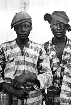 "Convicted Black men ""leased"" to harvest timber around 1915"