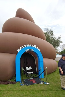 Enormous inflatable poop descends upon Lake Eola Park