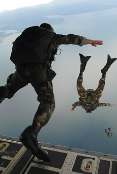 U.S. Air Force airmen out of Hurlburt Field, FL, jump out of a C-130J Hercules aircraft during water rescue training