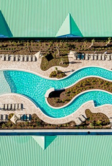 The newly installed beach-inspired lazy river pool deck at the Beachside Hotel & Suites