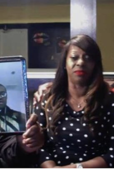 Floyd family with a picture of George Floyd who was a victim of police brutality