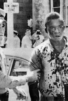 Charlie Griffin, a victim of the violence in Jacksonville on August 27, 1960, is detained by police.