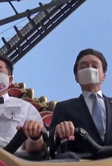 Two executives from the Fuji-Q Highland amusement park silently ride the the Fujiyama coaster