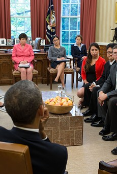 President Barack Obama and Vice President Joe Biden meet with DREAMers in the Oval Office, May 21, 2013.