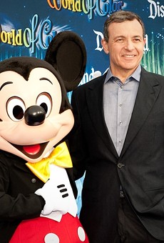 Mickey Mouse and Bob Iger on the red carpet. Iger stepped down as Disney CEO in February.