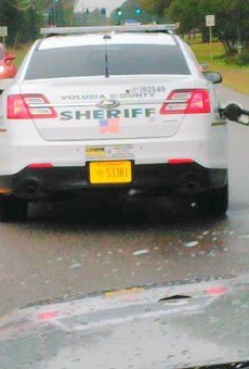 Volusia County deputy drives off with gas pump still attached to car