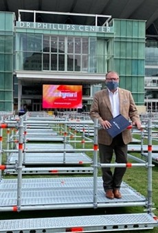 Mayor Dyer tries out a Frontyard Festival seating pod