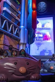 Riders on the 'Ratatouille' attraction.