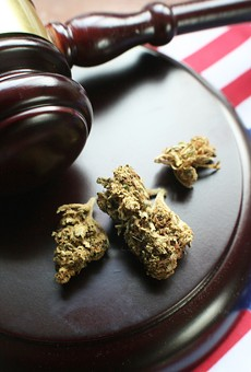 A gavel and marijuana flower