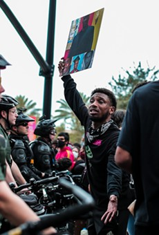 A protester at one of 2020's Black Lives Matters marches in downtown Orlando.