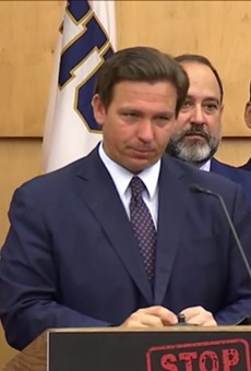 """Florida gov. Ron DeSantis called Florida """"America's West Berlin"""" during a news conference on Monday."""