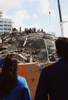Florida Gov. Ron DeSantis looks at the rubble of the Champlain Towers collapse.