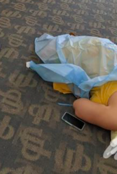 A photo of a woman lying on the floor while waiting for COVID-19 antibody treatment has gone viral.