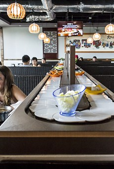 Nine Spices Hotpot, featuring an all-you-can-eat conveyor-belt, is a chaos of flavors and textures