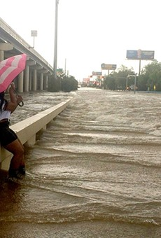 An umbrella didn't furnish a lot of protection Sunday morning at Yale and Interstate 10.