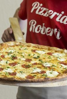 Pizzeria Roberti's dough, made after an in-house ferment, lends their pies an upper crust