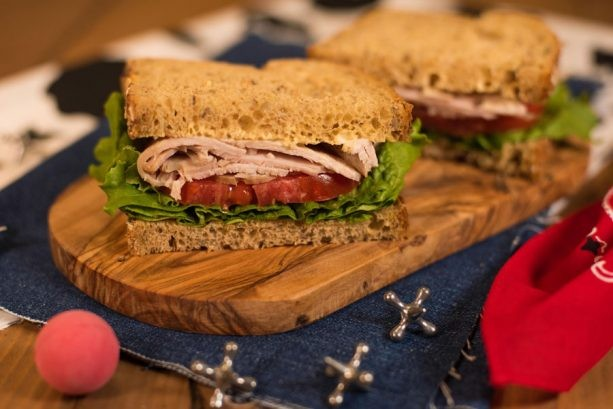 Smoked turkey, tomato, and lettuce on multigrain bread with a creamy dijonnaise. - PHOTO VIA DISNEY