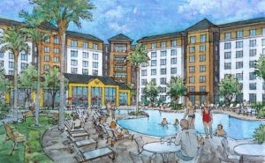 The pool area shared by Homewood Suites and Home2 Suites - IMAGE VIA DORADUS PARTNERS