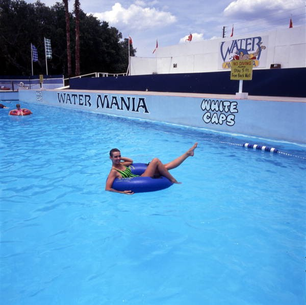 Woman riding inner tube at the Water Mania theme park in Kissimmee, Florida. 1989. - ROBERT M. OVERTON   IMAGE VIA STATE ARCHIVES OF FLORIDA