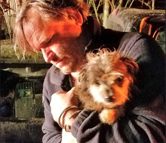Yoshi the dog and owner Jim Bronzo both survived the fire. - PHOTO VIA ORANGE COUNTY FIRE RESCUE/TWITTER