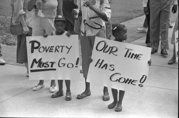 Two children protest poverty in Tallahassee in 1987. - PHOTO BY DEBORAH THOMAS VIA FLORIDA STATE ARCHIVE