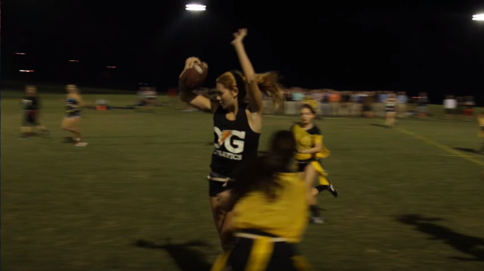 Roque jukes past a defender during an intramural flag football game. - PHOTO VIA YOUTUBE